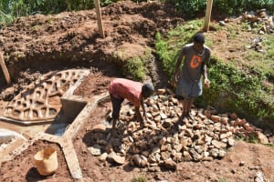 The Water Project: Bumira Community, Savai Spring -  Backfilling With Stones