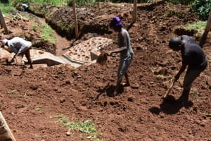The Water Project: Bumira Community, Savai Spring -  Backfilling With Soil