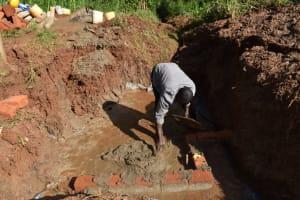 The Water Project: Bumira Community, Savai Spring -  Brick Setting