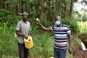 The Water Project: Bumira Community, Savai Spring -  Explaining Soap In Handwashing