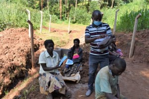 The Water Project: Bumira Community, Savai Spring -  Facilitator Distributing Materials