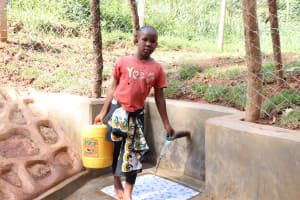 The Water Project: Bumira Community, Savai Spring -  Fetching Water