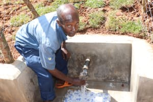 The Water Project: Bumira Community, Savai Spring -  Haron Collects Clean Water