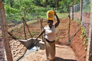 The Water Project: Bumira Community, Savai Spring -  Janet Carrying Clean Water