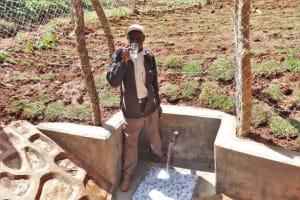 The Water Project: Bumira Community, Savai Spring -  John Shiraho Drinks Clean Water