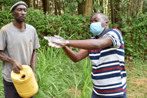 The Water Project: Bumira Community, Savai Spring -  Practical Handwashing Demonstration