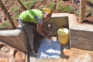 The Water Project: Bumira Community, Savai Spring -  Shihinji Rebeccar Washing Hands
