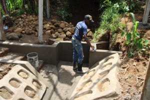 The Water Project: Shibikhwa Community, Musotsi Spring -  Plastering The Outer Walls