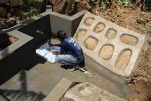 The Water Project: Shibikhwa Community, Musotsi Spring -  Tile Setting