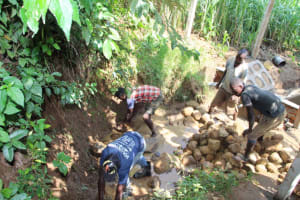The Water Project: Shibikhwa Community, Musotsi Spring -  Backfilling With Stone