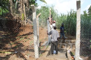 The Water Project: Shibikhwa Community, Musotsi Spring -  Fencing Chainlink