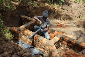 The Water Project: Shibikhwa Community, Musotsi Spring -  Discharge Pipe Setting