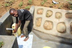 The Water Project: Shibikhwa Community, Musotsi Spring -  Alex Enjoy Washing Hands