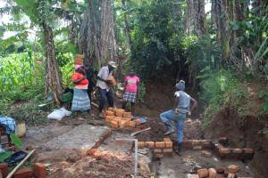 The Water Project: Shibikhwa Community, Musotsi Spring -  Community Members With Bricks
