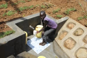 The Water Project: Shibikhwa Community, Musotsi Spring -  James Collecting Drinking Water