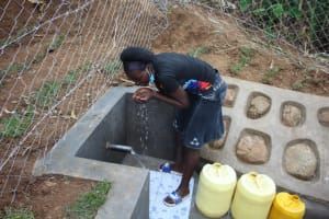The Water Project: Shibikhwa Community, Musotsi Spring -  Majory Enjoying Clean Water