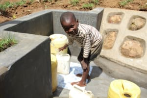 The Water Project: Shibikhwa Community, Musotsi Spring -  Patel Drawing Water At Protected Spring