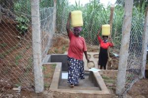 The Water Project: Shibikhwa Community, Musotsi Spring -  Women Carrying Water