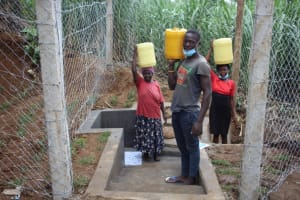 The Water Project: Shibikhwa Community, Musotsi Spring -  Carrying Clean Safe Water