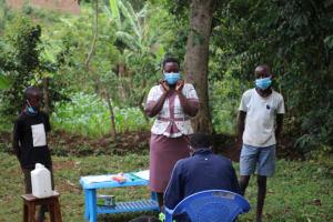 The Water Project: Shibikhwa Community, Musotsi Spring -  Demonstration On Mask Wearing