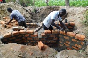 The Water Project: Shikokhwe Community, Mulika Spring -  Head Wall Contruction