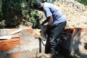 The Water Project: Shikokhwe Community, Mulika Spring -  Setting The Discharge Pipe