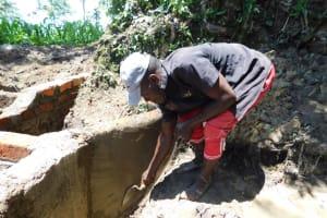 The Water Project: Shikokhwe Community, Mulika Spring -  Plastering Inside Walls