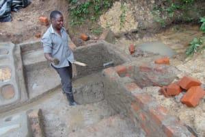 The Water Project: Shikokhwe Community, Mulika Spring -  Outside Plastering