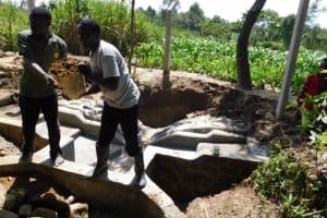 The Water Project: Shikokhwe Community, Mulika Spring -  Backfilling Clayworks