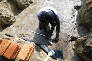 The Water Project: Shikokhwe Community, Mulika Spring -  Foundation Brick Setting