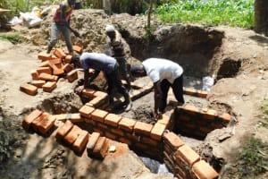 The Water Project: Shikokhwe Community, Mulika Spring -  Raising The Wall
