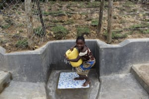 The Water Project: Shikokhwe Community, Mulika Spring -  Carrying Water
