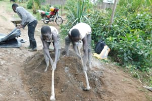 The Water Project: Shikokhwe Community, Mulika Spring -  Community Mixing Cement