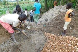 The Water Project: Shikokhwe Community, Mulika Spring -  Community Mixing Motar