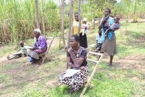 The Water Project: Shikokhwe Community, Mulika Spring -  Community Members Listening