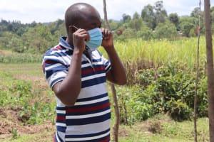 The Water Project: Shikokhwe Community, Mulika Spring -  Demonstrating A Mask