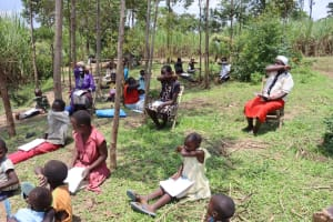 The Water Project: Shikokhwe Community, Mulika Spring -  Demonstration Coughing In Elbows