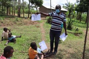 The Water Project: Shikokhwe Community, Mulika Spring -  Explaining Proper Water Storage