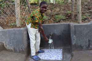 The Water Project: Shikokhwe Community, Mulika Spring -  Kevin Collecting Water