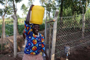 The Water Project: Shikokhwe Community, Mulika Spring -  Carrying Water Home