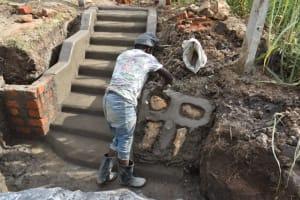 The Water Project: Mwera Community, Mukunga Spring -  Stone Pitching