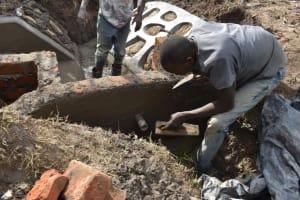 The Water Project: Mwera Community, Mukunga Spring -  Plastering Inside Headwall