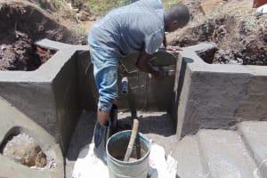 The Water Project: Mwera Community, Mukunga Spring -  Outside Plaster
