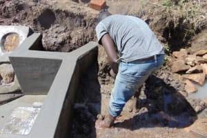 The Water Project: Mwera Community, Mukunga Spring -  Backfilling With Clay