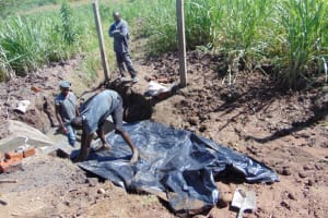 The Water Project: Mwera Community, Mukunga Spring -  Backfilling With Plastic