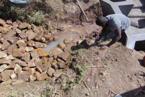 The Water Project: Mwera Community, Mukunga Spring -  Backfilling With Stone