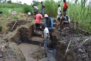 The Water Project: Mwera Community, Mukunga Spring -  Slab Setting