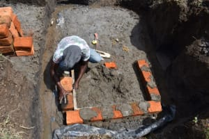 The Water Project: Mwera Community, Mukunga Spring -  Brick Setting