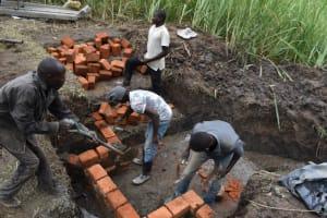 The Water Project: Mwera Community, Mukunga Spring -  Wall Construction