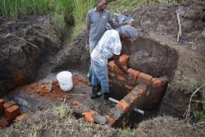 The Water Project: Mwera Community, Mukunga Spring -  Wall Setting